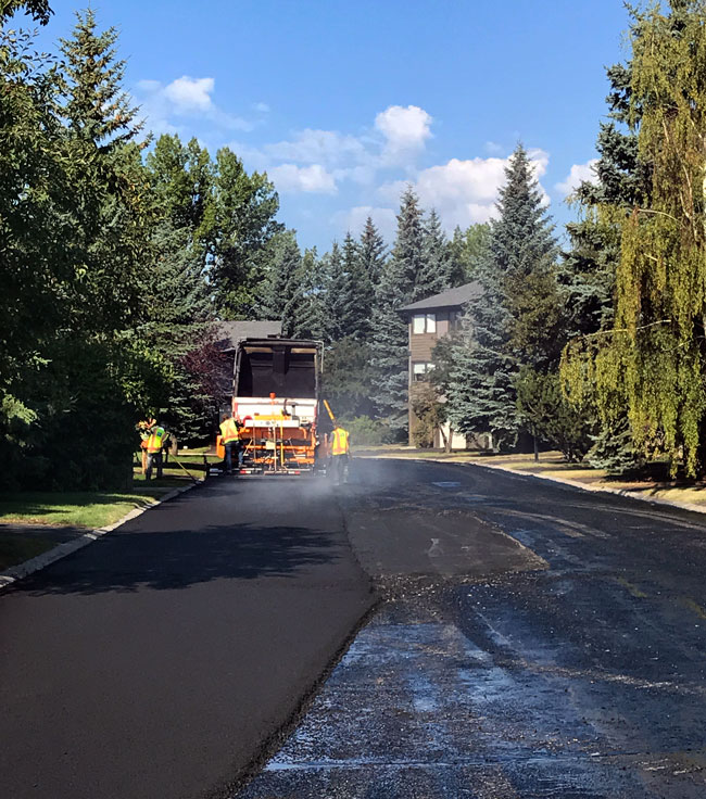 Photo of Workers Applying an Asphalt Overlay