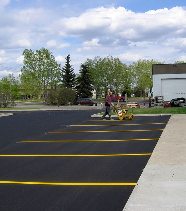 Photo of Painting Lines on Finished Asphalt Surface